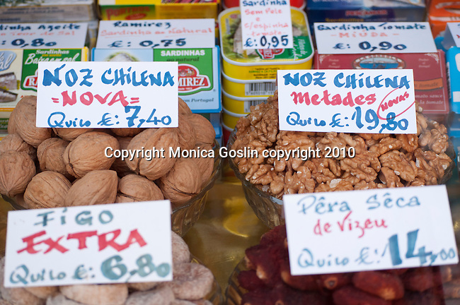 Nuts and other delicacies in a shop window in Porto, Portugal.