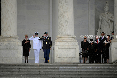 WASHINGTON, DC - AUGUST 31:  Mrs. McCain, left, with family as the casket of Sen. John McCain, R-Ariz., is carried up the steps of the U.S. Capitol in Washington D.C. on Friday, Aug. 31, 2018, in Washington, D.C. (Photo by John McDonnell/The Washington Post, Pool)