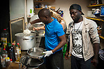 Two Afrcan migrants and some volunteers cook an African dish for dinner im Lakaxita. Irun (basque Country). August 28, 2018. Lakaxita is a self-managed socio-cultural space located in an occupied house, where volunteers have created a hosting network for migrants in transit who have already completed the 5-day period that can remain in public resources. This group of volunteers is avoiding a serious humanitarian problem Irún, the Basque municipality on the border with Hendaye. As the number of migrants arriving on the coasts of southern Spain incresead, more and more migrants are heading north to the border city of Irun. (Gari Garaialde / Bostok Photo)
