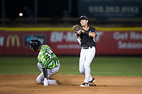 Salem-Keizer Volcanoes second baseman Kyle McPherson (2) attempts to turn a double play as D.J. Artis (34) slides into second base during a Northwest League game against the Eugene Emeralds at Volcanoes Stadium on August 31, 2018 in Keizer, Oregon. The Eugene Emeralds defeated the Salem-Keizer Volcanoes by a score of 7-3. (Zachary Lucy/Four Seam Images)