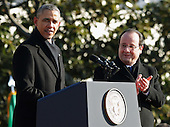 United States President Barack Obama and French President Francois Hollande deliver remarks during an official State Visit on the South Lawn of the White House February 11, 2014 in Washington, DC. The two leaders will hold bilateral meetings, a joint press conference and attend an official State Dinner later in the day.<br /> Credit: Chip Somodevilla / Pool via CNP