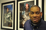 "Hasheem Kirkland, a vision impaired photographer, and his photograph ""Cyborg"" (far left), at Artist Reception for Seeing with Photography Collective SWPC, a group of visually impaired, sighted and totally blind photographers based in NYC, on Saturday, April 28, 2012, at African American Museum, Hempstead, New York, USA, and hosted by Long Island Center of Photography. Aperture published the group's ""Shooting Blind: Photographs by the Visually Impaired"" in 2005."
