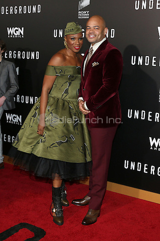 """WESTWOOD, CA - February 28: Aisha Hinds, Anthony Hemingway, At Premiere Of WGN America's """"Underground"""" Season 2, At The Regency Village Theatre In California on February 28, 2017. Credit: Faye Sadou/MediaPunch"""