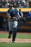 OAKLAND, CA - AUGUST 15:  Mike Zunino #3 of the Seattle Mariners chases a foul ball against the Oakland Athletics during the game at the Oakland Coliseum on Wednesday, August 15, 2018 in Oakland, California. (Photo by Brad Mangin)
