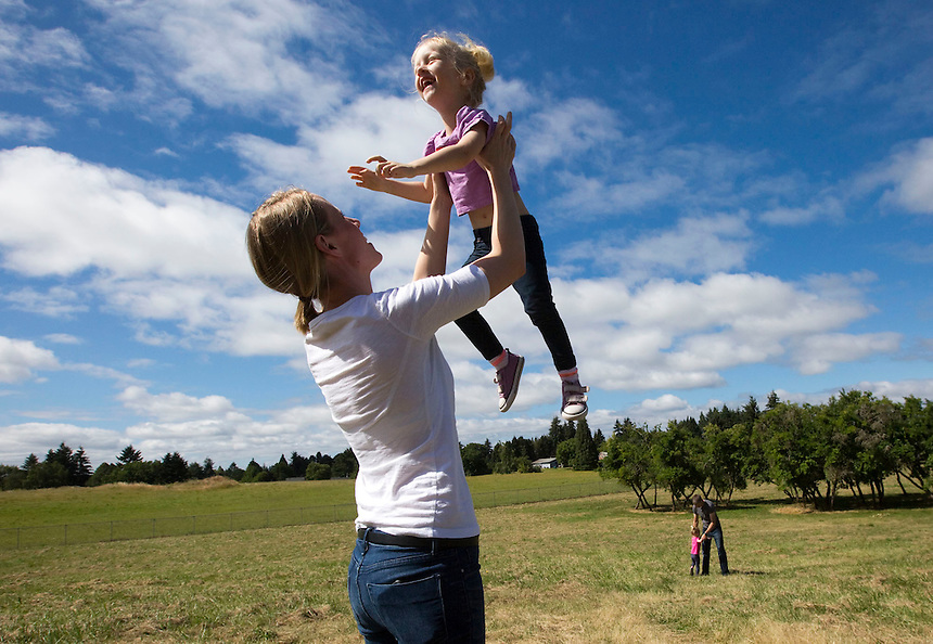 Kelsey Potter plays with her daughter Emmy at the Sorenson Neighborhood Park in Vancouver Thursday June 30, 2016. The park is one of two neighborhood parks will be built this summer to provide additional recreation within easy walking distance of nearby residents. (Photo by Natalie Behring/ The Columbian)