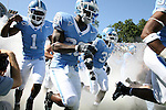 02 September 2006: UNC's Brooks Foster (1), Jordan Hemby (23) and Bryan Dixon (30) race onto the field before the game. The University of North Carolina Tarheels lost 21-16 to the Rutgers Scarlett Knights at Kenan Stadium in Chapel Hill, North Carolina in an NCAA Division I College Football game.