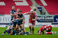 Saturday 10 May 2014<br /> Pictured:( l-r) Lewis Jones throws the ball back while Jake Ball  of the Scarlets Chases<br /> Re: Scarlets v Blues Rabo Direct Pro 12 Rugby Union Match at Parc y Scarlets, Llanelli, Wales