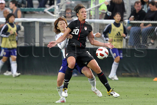 18.05.2011 United States' Abby Wambach (20) and Japan's Mizuho Sakaguchi (left). The United States Women's National Team defeated the Japan Women's National Team 2-0 at WakeMed Stadium in Cary, North Carolina as part of preparations for the 2011 Women's World Cup.