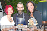 BURGERS: John Harty of Rubens Restaurant, Ashe Street, Tralee who hosted the Bar B Que in aid of the Tralee Women Resoursce Centre,on Friday night, given John a hand in eating the food were l-r: Amanda Brosnan and Carmel Hanley.....