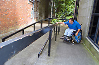 Wheelchair person using the ramp and handrails. This image may only be used to portray the subject in a positive manner..©shoutpictures.com..john@shoutpictures.com
