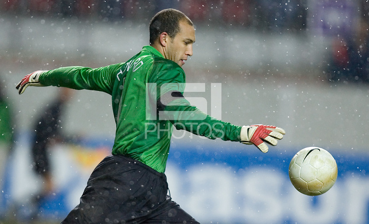 Tim Howard on a goal kick in the snow at Fritz-Walter Stadium, Kaiserslautern, Germany, Wednesday, March 1, 2006. USA 1-0.