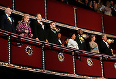 The 2004 Kennedy Center Honorees (L-R) conductor John Williams, opera diva Joan Sutherland, actor Warren Beatty, music legend Elton John, and actors Ruby Dee and Ossie Davis join U.S. first lady Laura Bush and United States President George W. Bush in the presidential box at the Kennedy Center December 5, 2004 in Washington, DC. The six honorees were saluted for their lifetime contributions to American culture through the performing arts. .Credit: Win McNamee - Pool via CNP