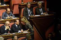Roma, 2 Ottobre 2013<br /> Senato <br /> Silvio Berlusconi parla con Alessandra Mussolini dagli scranni del PDL durante l'intervento del Primo  Ministro Enrico Letta