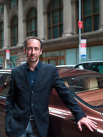 Bentley's Chief Designer, Daniele Ceccomori, stands beside a Bentley Mulsanne in the street outside the St Regis Hotel in New York
