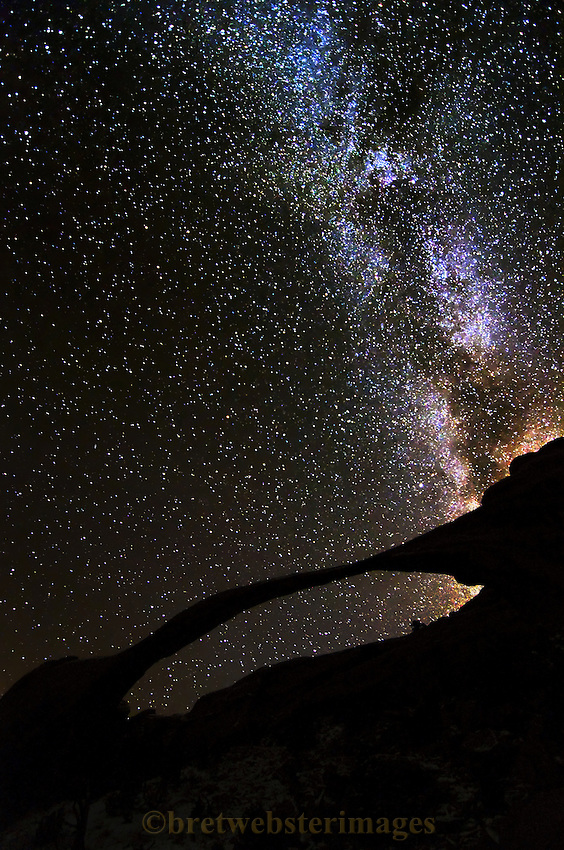 "Landscape Arch shows why it's the true ""Delicate Arch"" with the Milky Way as a backdrop."
