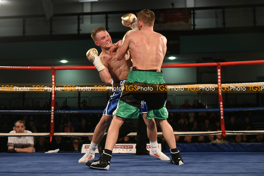 Craig Whyatt (blue shorts) defeats Josh Thorne during a Boxing Show at the Westcroft Leisure Centre on 11th February 2017
