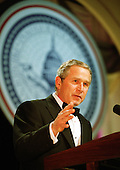 United States President George W. Bush makes remarks at one of the nine inaugural balls in Washington, D.C. on January 20, 2001..Credit: Robert Trippett / Pool via CNP.