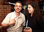 Indrani Sen with Francesco Ilardi who manages Setauket Pizzaria and is also a poet at work at the Setauket restaurant on Monday May 3, 2004. (Photo / Jim Peppler).