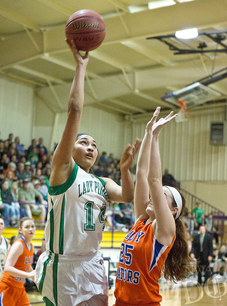 Greenland's Kim Crown puts up a shot over Two Rivers Grace Coates as she goes in for a layup during Saturday's 3A Regional final in Lavaca.