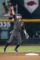 Vanderbilt Commodores shortstop Dansby Swanson (7) tracks a pop up during the NCAA College baseball World Series against the Cal State Fullerton Titans on June 14, 2015 at TD Ameritrade Park in Omaha, Nebraska. The Titans were leading 3-0 in the bottom of the sixth inning when the game was suspended by rain. (Andrew Woolley/Four Seam Images)