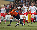 Simon Heslop of Luton and Tim Sills of Stevenage Borough battle for possession during the  Blue Square Premier match between Stevenage Borough and Luton Town at the Lamex Stadium, Broadhall Way, Stevenage on Saturday 3rd April, 2010..© Kevin Coleman 2010 .