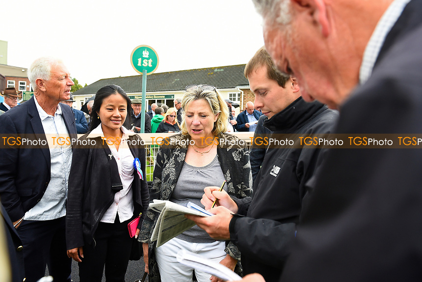 Trainer Eve Johnson Houghton gives an interview with the racing press in the winners enclosure during Whitsbury Manor Stud Bibury Cup Day Racing at Salisbury Racecourse on 28th June 2017