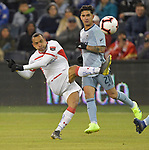 Felipe Pardo (left) of Toluca shoots on goal as Felipe Gutierrez of Sporting KC watches during their CONCACAF Champions League game on February 21, 2019 at Children's Mercy Park in Kansas City, KS.<br /> Tim VIZER/Agence France-Presse