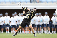 CHAPEL HILL, NC - MARCH 10: Trevor Weingarten #85 of Bryant University scores a goal during a game between Bryant and North Carolina at Dorrance Field on March 10, 2020 in Chapel Hill, North Carolina.