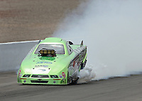 Apr. 7, 2013; Las Vegas, NV, USA: NHRA top alcohol funny car driver Doug Gordon blows an engine during the Summitracing.com Nationals at the Strip at Las Vegas Motor Speedway. Mandatory Credit: Mark J. Rebilas-