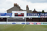 Dagenham and Redbridge 1 Burton Albion 3, 21/02/2015. Victoria Road, League Two. Scoreboard with the wrong team. Burton Albion moved to the top of League Two following a hard-fought win over Dagenham & Redbridge played in-front of 1,718 supporters. Photo by Simon Gill.