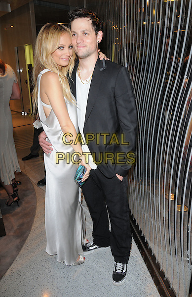 NICOLE RICHIE & JOEL MADDEN .The Opening of Alberta Ferretti Flagship on Melrose hosted by Alberta Ferretti, Marisa Tomei, Lucy Lui & Vogue in Los Angeles, California, USA..November 12th, 2008.full length couple silk satin dress black suit jacket couple hug embrace long.CAP/DVS.©Debbie VanStory/Capital Pictures.
