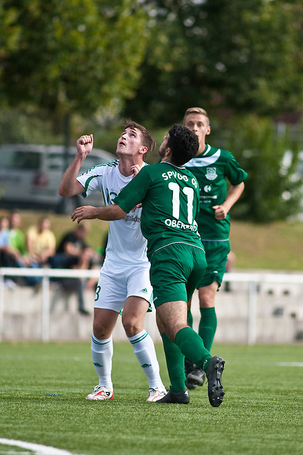 ALSBACH, GERMANY - SEPTEMBER 01: Verbandsliga match between FC Alsbach (white) and SpVgg. 05 Oberrad (green) at FC Alsbach sports ground on September 01, 2012 in Alsbach, Germany. (Photo by Dirk Markgraf)