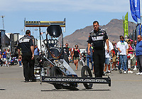 Apr 10, 2015; Las Vegas, NV, USA; Crew members with the car of NHRA top fuel driver Tony Schumacher in the pits during qualifying for the Summitracing.com Nationals at The Strip at Las Vegas Motor Speedway. Mandatory Credit: Mark J. Rebilas-