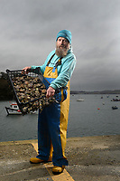 BNPS.co.uk (01202) 558833. <br /> Pic: ZacharyCulpin/BNPS<br /> <br /> The Lone Ranger - Oyster gatherer Christopher Ranger pictured with a tiny catch on The Fal estuary.<br /> <br /> A concerned oyster fisherman is crowdfunding to set up his very own 'micro-hatchery' in a bid to restore the UK's dwindling stocks of the shellfish.<br /> <br /> Chris Ranger, 44, currently runs Britain's last surviving oyster fishery on the River Fal in Mylor Churchtown, Cornwall.<br /> <br /> The site has been a hotbed for oyster activity for thousands of years but they are now on the brink of vanishing after years of overfishing.
