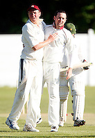 Brad Sculley (L) congratulates Darren Eckford (R) after Eckford dismissed an Enfield player during the Middlesex County Cricket League Division Two game between North Middlesex and Enfield at Park Road, Crouch End, London on Sat May 22, 2010