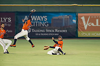 AZL Giants center fielder Ismael Munguia (29) avoids contact with Robert Antunez (34) on a shallow pop fly during the game against the AZL Reds on August 12, 2017 at Scottsdale Stadium in Scottsdale, Arizona. AZL Giants defeated the AZL Reds 1-0. (Zachary Lucy/Four Seam Images)
