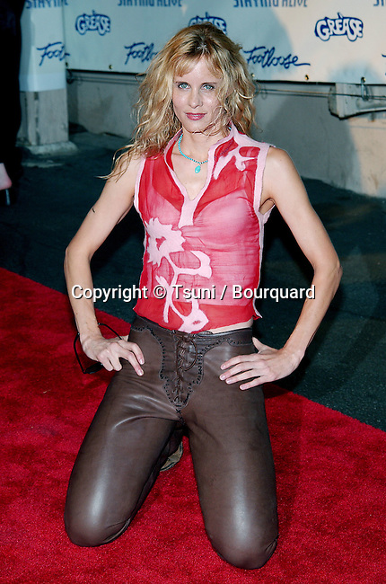 """Lori Singer arriving at the party for the Paramount DVD Release of 70' movies """""""" Grease, Saturday Night Fever, Flashdance, Footloose, Urban Cowboy and Staying Alive """""""" on the back lot of the Paramount Studio in Los Angeles. September 24, 2002.           -            SingerLori47.jpg"""