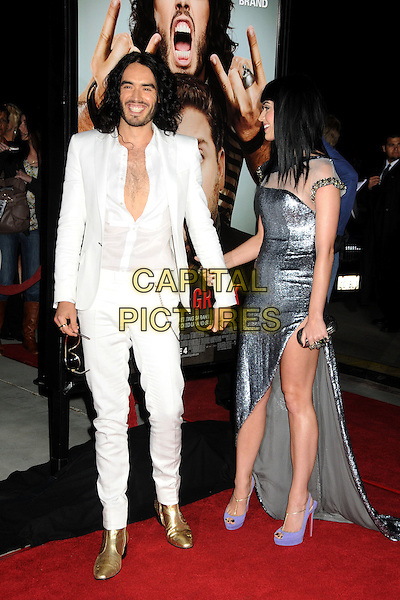 "RUSSEL BRAND & KATY PERRY.""Get Him To The Greek"" Los Angeles Premiere held at The Greek Theatre, Los Angeles, California, USA..May 25th, 2010.full length silver dress sheer slit split purple slingback shoes side clutch bag white shirt jacket trousers gold boots couple smiling laughing unbuttoned.CAP/ADM/BP.©Byron Purvis/AdMedia/Capital Pictures."