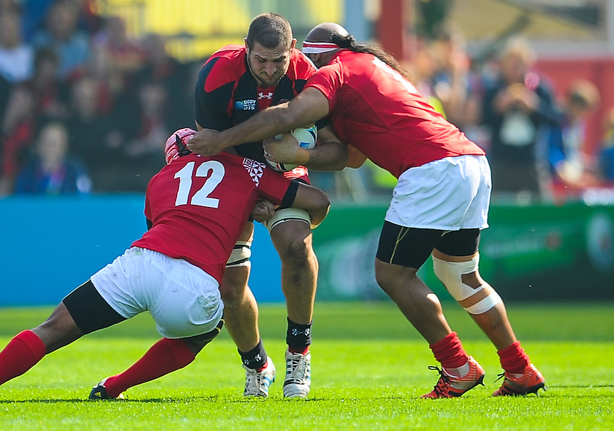 Georgia's Kote Mikautadze is tackled by Tonga's Siale Piutau and Halani 'Aulika<br /> <br /> Photographer Craig Thomas/CameraSport<br /> <br /> Rugby Union - 2015 Rugby World Cup - 12;00  Georgia v Tonga - Saturday 19th September 2015 - Kingsholm - Gloucester <br /> <br /> &copy; CameraSport - 43 Linden Ave. Countesthorpe. Leicester. England. LE8 5PG - Tel: +44 (0) 116 277 4147 - admin@camerasport.com - www.camerasport.com
