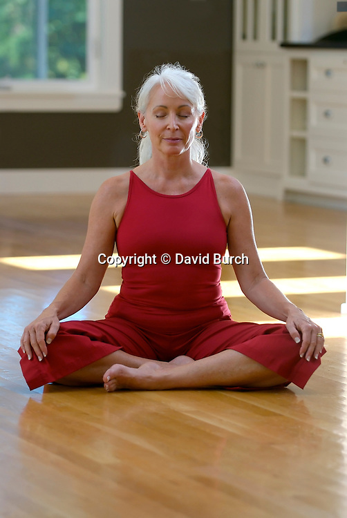 Mature woman in lotus position