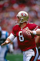 SAN FRANCISCO, CA - Quarterback Steve Young of the San Francisco 49ers in action during a game against the Carolina Panthers at Candlestick Park in San Francisco, California in 1996. Photo by Brad Mangin