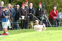 THOMASTOWN, IRELAND. Tiger Woods playing his second shot on the 6th from the face of the bunker during the American Express Championship day two at the Mount Juliet Golf Club on October 1th, 2004 in Thomastown, Ireland ..Photo AFP/NEWSFILE/FRAN CAFFREY..(Photo credit should read FRAN CAFFREY/NEWSFILE/AFP)...This Picture has been sent you under the condtions enclosed by:.Newsfile Ltd..the Studio,.Millmount Abbey,.Drogheda,.Co Meath..Ireland..Tel: +353(0)41-9871240.Fax: +353(0)41-9871260.GSM: +353(0)86-2500958.email: pictures@newsfile.ie.www.newsfile.ie.FTP: 193.120.102.198..This picture is from Fran Caffrey@newsfile.ie