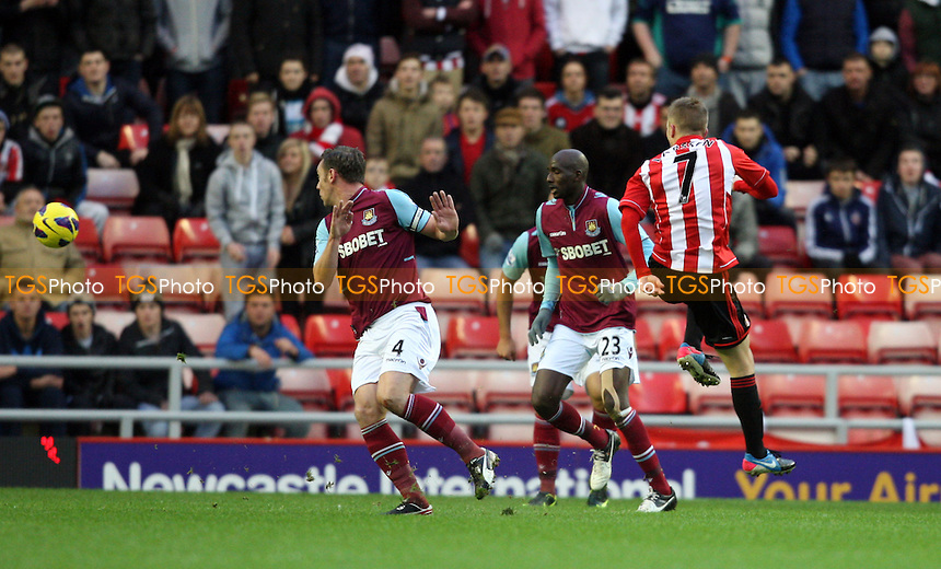 Sebastian Larsson scores the 1st goal for Sunderland - Sunderland vs West Ham United, Barclays Premier League at The Stadium of Light, Sunderland - 12/01/13 - MANDATORY CREDIT: Rob Newell/TGSPHOTO - Self billing applies where appropriate - 0845 094 6026 - contact@tgsphoto.co.uk - NO UNPAID USE.