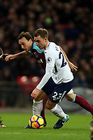 Christian Eriksen of Tottenham and Mark Noble of West Ham United during Tottenham Hotspur vs West Ham United, Premier League Football at Wembley Stadium on 4th January 2018