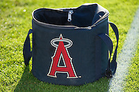 A ball bag with the logo of the Los Angeles Angels of Anaheim sits on the field when the Orem Owlz faced the Ogden Raptors at Lindquist Field on August 28, 2013 in Ogden Utah.  (Stephen Smith/Four Seam Images)