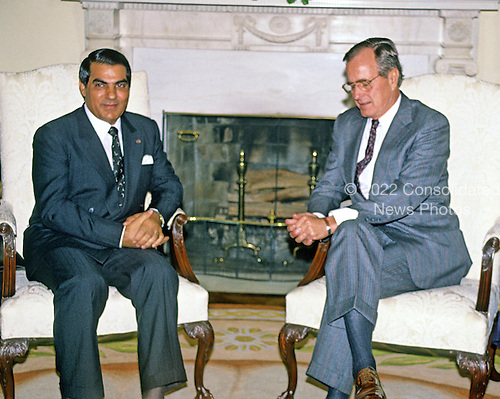 United States President George H.W. Bush, right, meets President Zine El Abidine Ben Ali of Tunisia in the Oval Office of the White House in Washington, D.C. on November 16, 1989..Credit: Ron Sachs / CNP