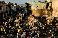 Vendors sell their wares in the La Saline market near Grand Rue on November 30, 2017 near Port-au-Prince, Haiti. Due to the lack off an effective state garbage disposal system - garbage piles up on streets in many areas of Port-au-Prince and is burnt off daily as a means of removing the refuse. <br /> Photo Daniel Berehulak for The New York Times