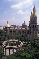 The Rotunda de los Jaliscenes Ilustres and cathedral in downtown Guadalajara, Mexico