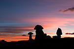 Hoodoos are silhouetted at sunset in Goblin Valley State Park, Utah.