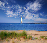 The Blue Lake Michigan Water And Sand Beach At The Frankfort North Breakwater Lighthouse On An Early Summer Morning,  Frankfort Michigan, USA